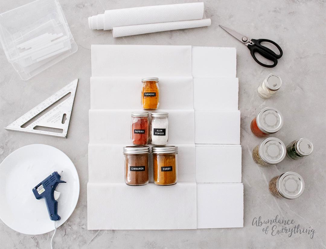 (Testing spice jars on foam board shelf) – EKKK! So cute.