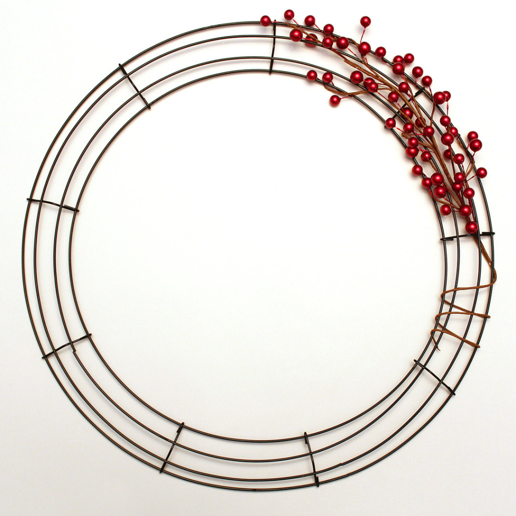 Start by wrapping the wired stems around your wreath